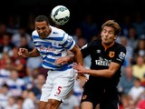 Rio Ferdinand of QPR and Nikica Jelevic of Hull City
