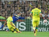 Nantes' French forward Yacine Bammou (L) scores a goal during the French L1 football match Nantes (FCNA) vs Lens (RCL) at the Beaujoire stadium, on August 9, 2014