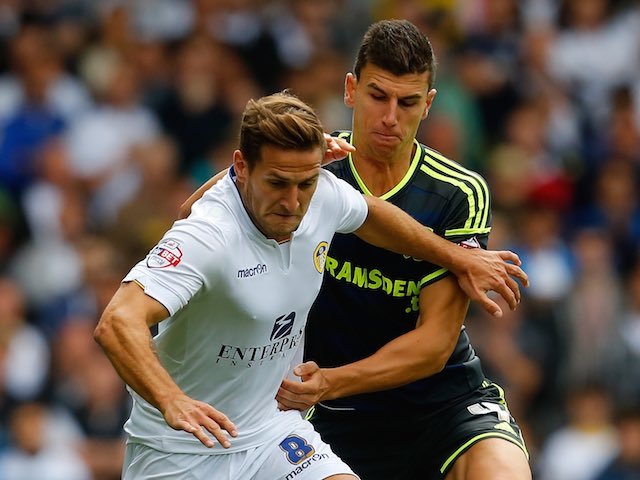 Leeds's Billy Sharp and Middlesbrough's Daniel Ayala grapple for the ball on August 16, 2014