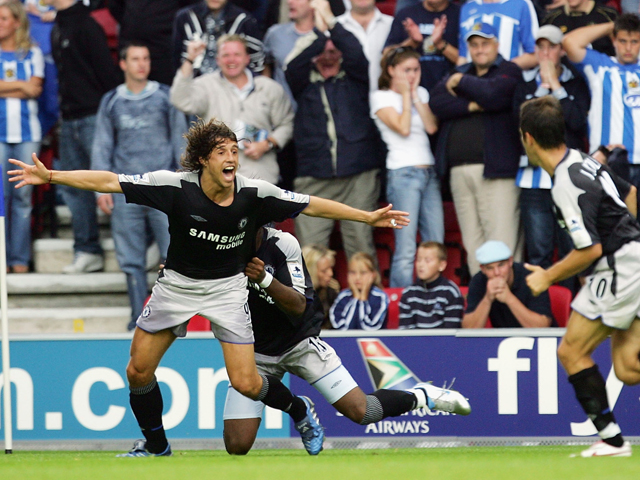 Hernan Crespo of Chelsea is mobbed after scoring the last minute winner, during the Barclays Premiership match between Wigan Athletic and Chelsea on August 14, 2005
