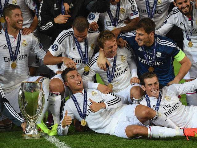 Real Madrid players Ronaldo (c) and Gareth Bale (r) celebrate with team mates and the trophy after the UEFA Super Cup match against Sevilla on August 12, 2014