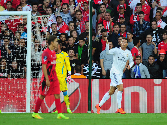 Real Madrid player Ronaldo (r) celebrates after scoring the opening goal during the UEFA Super Cup match between Real Madrid and Sevilla FC at Cardiff City Stadium on August 12, 2014