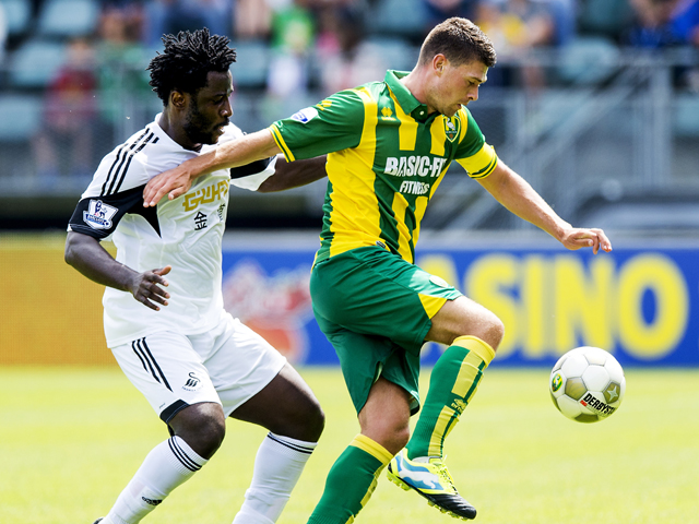 Swansea City's Dutch player Wilfried Bony vies with Danny Holla from ADO Den Haag during their friendly football match at the Kyocera stadion in The Hague, on July 13, 2013