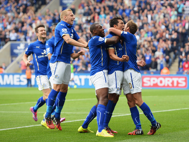 Leonardo Ulloa of Leicester City celebrates scoring his goal with team mates during the Barclays Premier League match between Leicester City and Everton at the King Power Stadium on August 16, 2014