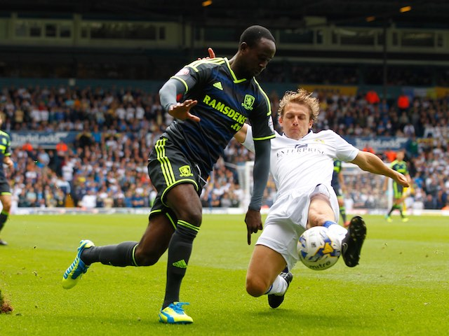 Leeds's Stephen Warnock slides in to take the ball from Albert Adomah of Middlesbrough on August 16, 2014