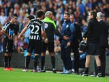 Assistant Manager of Aston Villa Roy Keane exchanges words with Daryl Janmaat of Newcastle United during the Barclays Premier League match between Aston Villa and Newcastle United at Villa Park on August 23, 2014