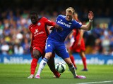 Jeffrey Schlupp of Leicester City battles with Andre Schurrle of Chelsea during the Barclays Premier League match between Chelsea and Leicester City at Stamford Bridge on August 23, 2014