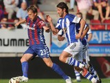 Eibar's midfielder Javier Lara vies with Real Sociedad's forward Esteban Granero during the Spanish league football match SD Eibar vs Real Sociedad at the Ipurua stadium in Eibar on August 24, 2014