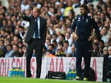 Harry Redknapp (L), the QPR manager gives instructions watched by Mauricio Pochettino, the Spurs manager during the Barclays Premier League match on August 24, 2014