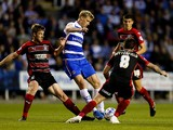 Pavel Pogrebnyak of Reading is tackled by Paul Dixon and Jacob Butterfield of Huddersfield during the Sky Bet Championship match between Reading and Huddersfield Town at Madejski Stadium on August 19, 2014