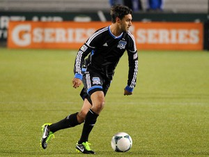 Chris Wondolowski #8 of the San Jose Earthquakes moves up the field during the second half of the game against AIK at JELD-WEN Field on February 20, 2013