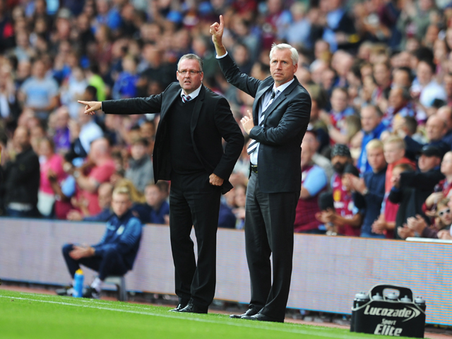 Manager Paul Lambert of Aston Villa gives instructions with Alan Pardew, manager of Newcastle United during the Barclays Premier League match between Aston Villa and Newcastle United at Villa Park on August 23, 2014