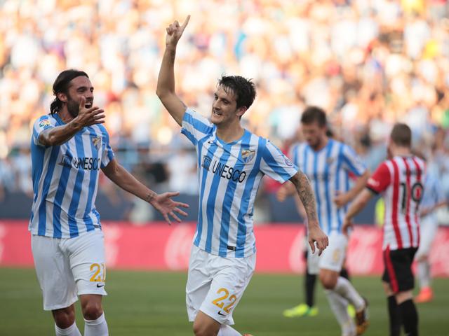 Luis Alberto of Malaga CF celebrates with Sergio Sanchez after scoring against Athletic Club Bilbao at La Rosaleda Stadium on August 23, 2014
