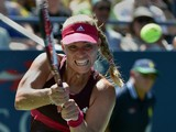 Angelique Kerber of Germany returns a shot to Ksenia Pervak of Russia during their 2014 US Open women's singles match at the USTA Billie Jean King National Tennis Center August 25, 2014