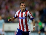 Mario Mandzukic of Atletico de Madrid celebrates scoring their second goal during the La Liga match between Club Atletico de Madrid and SD Eibar at Vicente Calderon Stadium on August 30, 2014