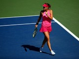 Belinda Bencic of Switzerland reacts against Angelique Kerber of Germany during their women's singles third round match on Day Five of the 2014 US Open at the USTA Billie Jean King National Tennis Center on August 29, 2014