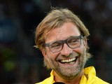 Dortmund's headcoach Jurgen Klopp laughs during an interview prior to the German first division Bundesliga football match FC Augsburg vs Borussia Dortmund in Augsburg, southern Germany, on August 29, 2014