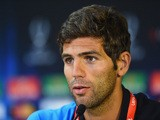 Federico Fazio of Sevilla FC talks to the media during the Sevilla FC press conference at Cardiff City Stadium on August 11, 2014