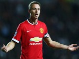Jonny Evans of Manchester United shows his frustration during the Capital One Cup Second Round match against MK Dons on August 26, 2014