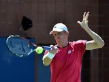 Kevin Anderson of South Africa returns a shot to Jerzy Janowicz of Poland during their 2014 US Open men's singles match at the USTA Billie Jean King National Tennis Center on August 29, 2014
