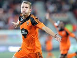 Lorient's French forward Valentin Lavigne jubilates after scoring a goal during the French L1 football match Lorient vs Guingamp on August 30, 2014