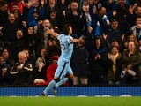Manchester City's Argentinian striker Sergio Aguero celebrates scoring their third goal in front of the City supporters during the English Premier League football match between Manchester City and Liverpool at the Etihad Stadium in Manchester, north-west
