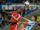 Michail Antonio of Nottingham Forest heads past Tom Smith of Huddersfield during the Capital One Cup Second Round match on August 26, 2014