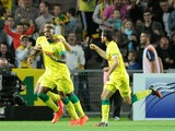 Nantes' Togolese forward Serge Gakpe celebrates with teammates after scoring a goal during the French L1 football match between Nantes (FCN) and Montpellier (MHSC) on August 30, 2014