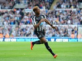 Rolando Aarons of Newcastle United celebrates scoring their second goal during the Barclays Premier League match between Newcastle United and Crystal Palace at St James' Park on August 30, 2014