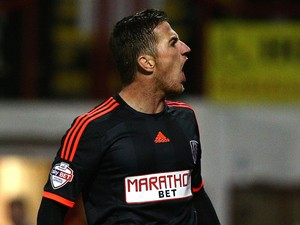 Ross McCormack of Fulham celebrates after scoring the first goal of the game during the Capital One Cup Second Round match against Brentford on August 26, 2014