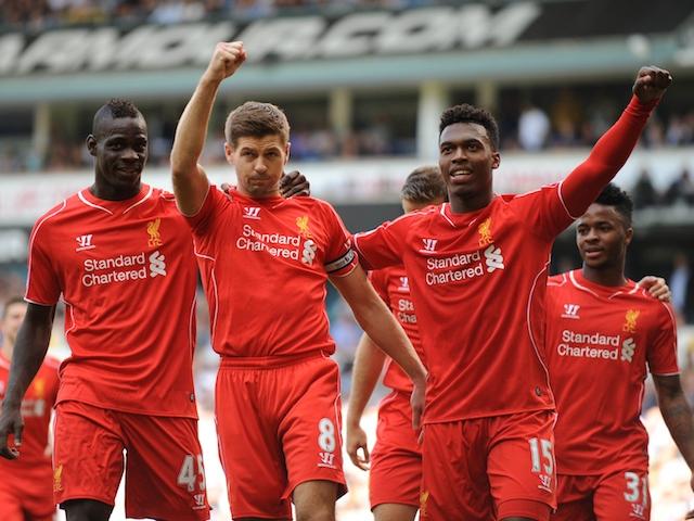 Liverpool's English midfielder Steven Gerrard (R) celebrates scoring a penalty against Tottenham on August 31, 2014