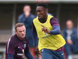 England captain Wayne Rooney tries to tackles Danny Welbeck during a England training session before the international friendly match against Norway at London Colney on September 1, 2014