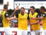 Marc Richards of Northampton Town celebrates with team mates after scoring his sides 1st goal during the Sky Bet League Two match against Dagenham & Redbridge on September 6, 2014