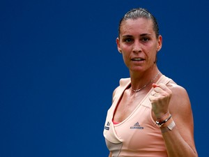 Flavia Pennetta of Italy reacts to a point against Casey Dellacqua of Australia during their women's singles fourth round match on Day Eight of the 2014 US Open at the USTA Billie Jean King National Tennis Center on September 1, 2014