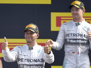 British driver Lewis Hamilton celebrates next to second placed Mercedes' German driver Nico Rosberg on the podium after the Italian Formula One Grand Prix motor race at the Autodromo Nazionale circuit in Monza on September 7, 2014