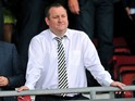 Newcastle United's English owner Mike Ashley gestures before the English Premier League football match between Southampton and Newcastle United at St Mary's Stadium in Southampton on September 13, 2014