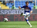 Manolo Gabbiadini of UC Sampdoria scores the opening goal during the Serie A match between UC Sampdoria and Torino FC at Stadio Luigi Ferraris on September 14, 2014