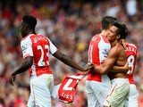 Alexis Sanchez of Arsenal celebrates scoring their second goal with Mesut Oezil and Danny Welbeck of Arsenal during the Barclays Premier League match between Arsenal and Manchester City at Emirates Stadium on September 13, 2014