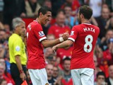 Angel Di Maria of Manchester United is congratulated