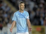 Malmo's Markus Rosenberg reacts after his double score in the UEFA Champions League play-off second leg soccer match against FC Red Bull Salzburg on August 27, 2014