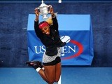 Serena Williams jumps for joy with the trophy after winning the US Open in New York on September 7, 2014