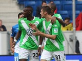 Wolfsburg's players celebrate scoring during the German first division Bundesliga football match 1899 Hoffenheim vs VfLWolfsburg in Sinsheim, southwestern Germany on September 13, 2014