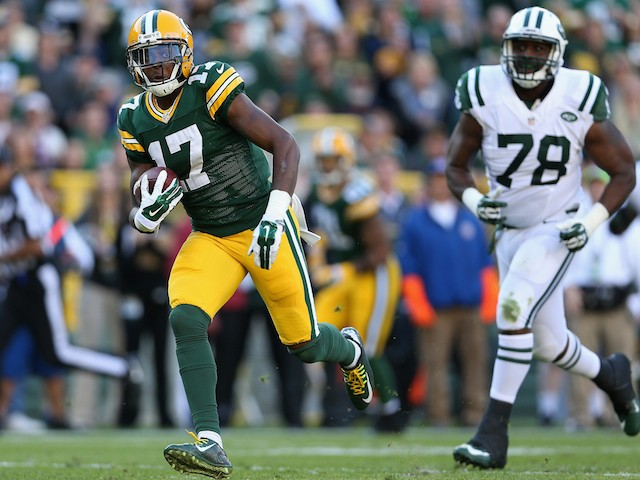 Wide receiver Davante Adams #17 of the Green Bay Packers runs with the football after receiving a 24 yard pass ahead of defensive tackle Leger Douzable on September 14, 2014