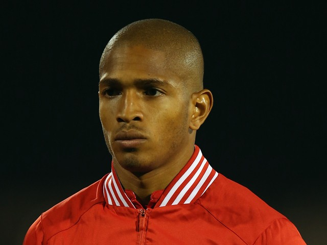 Simeon Jackson of Canada stands for the National Anthems prior to the International Friendly between Canada and Australia at Craven Cottage on October 15, 2013