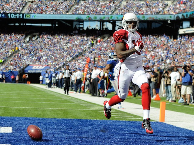 Wide receiver Ted Ginn #19 of the Arizona Cardinals celebrates a touchdown after running back a punt against the New York Giants on September 14, 2014