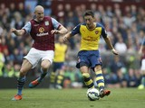 Arsenal's German midfielder Mesut Ozil shoots to score the opening goal during the English Premier League football match between Aston Villa and Arsenal at Villa Park in Birmingham, central England on September 20, 2014