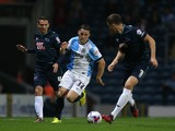 Craig Conway of Blackburn Rovers controls the ball from Craig Bryson of Derby County during the Sky Bet Championship match between Blackburn Rovers and Derby County at Ewood Park on September 17, 2014