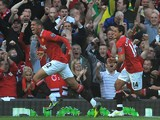 Manchester United's English defender Chris Smalling (L) celebrates after scoring the opening goal of the English Premier League football match against Chelsea on September 18, 2011