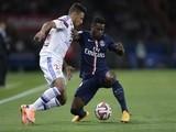 Lyon's French midfielder Corentin Tolisso (L) vies with Paris Saint-Germain's French