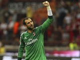 Diego Lopez of AC Milan celebrates a victory at the end of the Serie A match between AC Milan and SS Lazio at Stadio Giuseppe Meazza on August 31, 2014